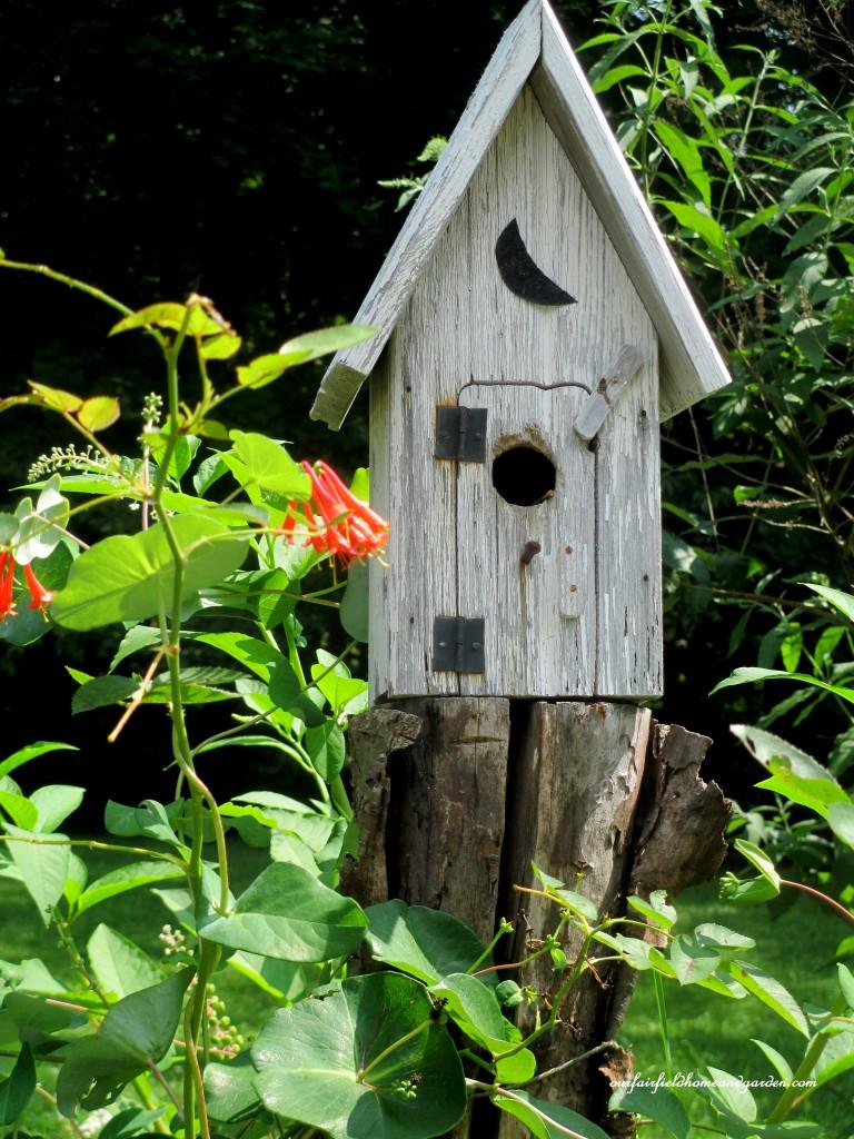 Birdhouse on the fencepost http://ourfairfieldhomeandgarden.com/in-a-summer-garden-our-fairfield-home-garden/