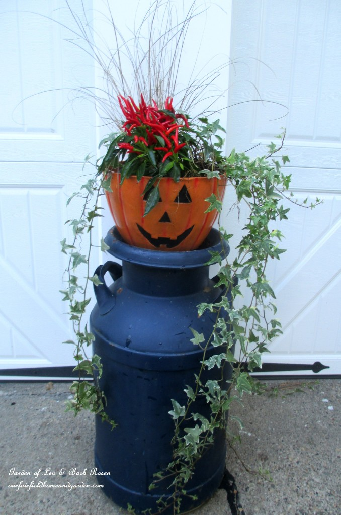 Fall planter on a milk can stand https://ourfairfieldhomeandgarden.com/fall-outdoor-decor-our-fairfield-home-and-garden/