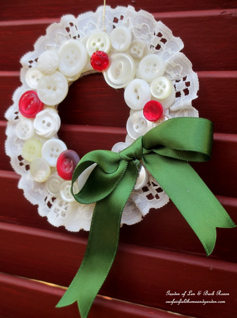 Green Ribboned Button Wreath https://ourfairfieldhomeandgarden.com/vintage-button-wreath-ornament-a-diy-in-your-sewing-basket/