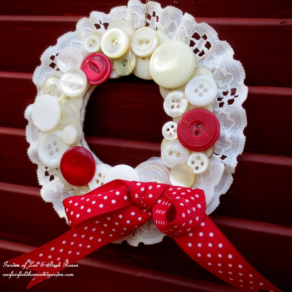 Red Ribboned Button Wreath https://ourfairfieldhomeandgarden.com/vintage-button-wreath-ornament-a-diy-in-your-sewing-basket/