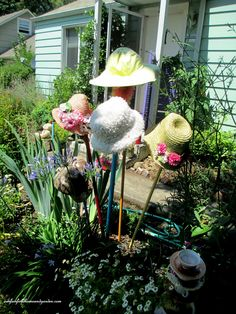 Garden Hats as garden accents! http://ourfairfieldhomeandgarden.com/unexpected-garden-accents/