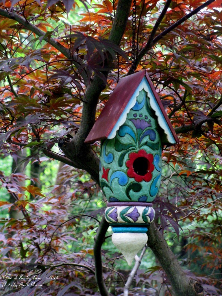 Colorful Carved Birdhouse http://ourfairfieldhomeandgarden.com/unexpected-garden-accents/