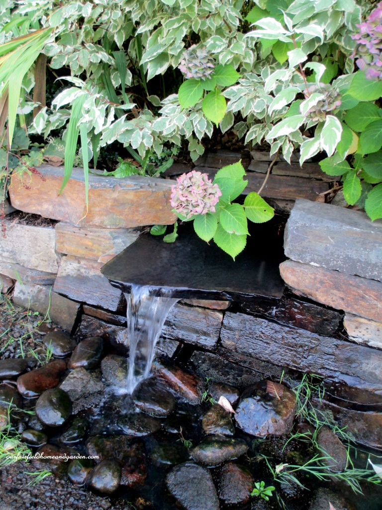 Stone Wall Fountain https://ourfairfieldhomeandgarden.com/unexpected-garden-accents/