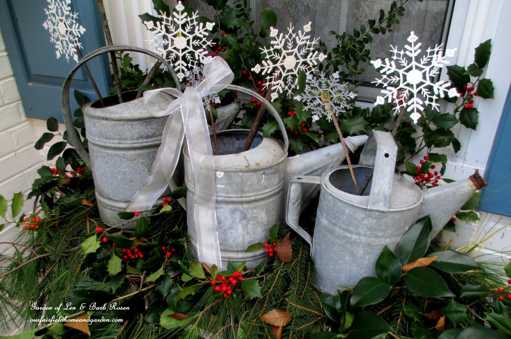 Rustic Wateringcans Windowbox http://ourfairfieldhomeandgarden.com/rustic-watering-cans-windowboxes-more/