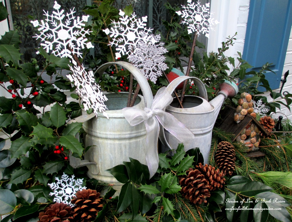 Rustic Winter Windowbox https://ourfairfieldhomeandgarden.com/rustic-watering-cans-windowboxes-more/