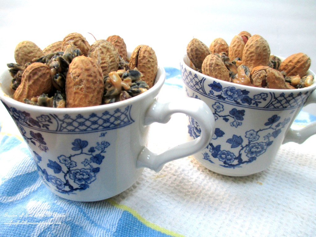 Teacups filled with suet mix. https://ourfairfieldhomeandgarden.com/birdfeeders-use-what-you-have/