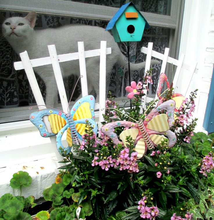 Winowbox with Geraniums and Angelonia https://ourfairfieldhomeandgarden.com/spring-windowboxes/