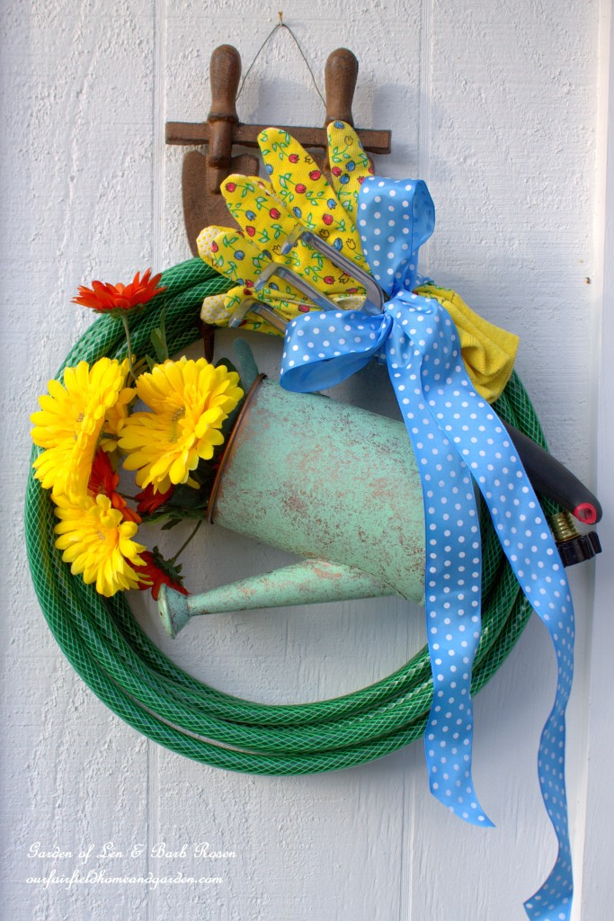 Hose Wreath with Watering Can http://ourfairfieldhomeandgarden.com/diy-garden-hose-wreaths/