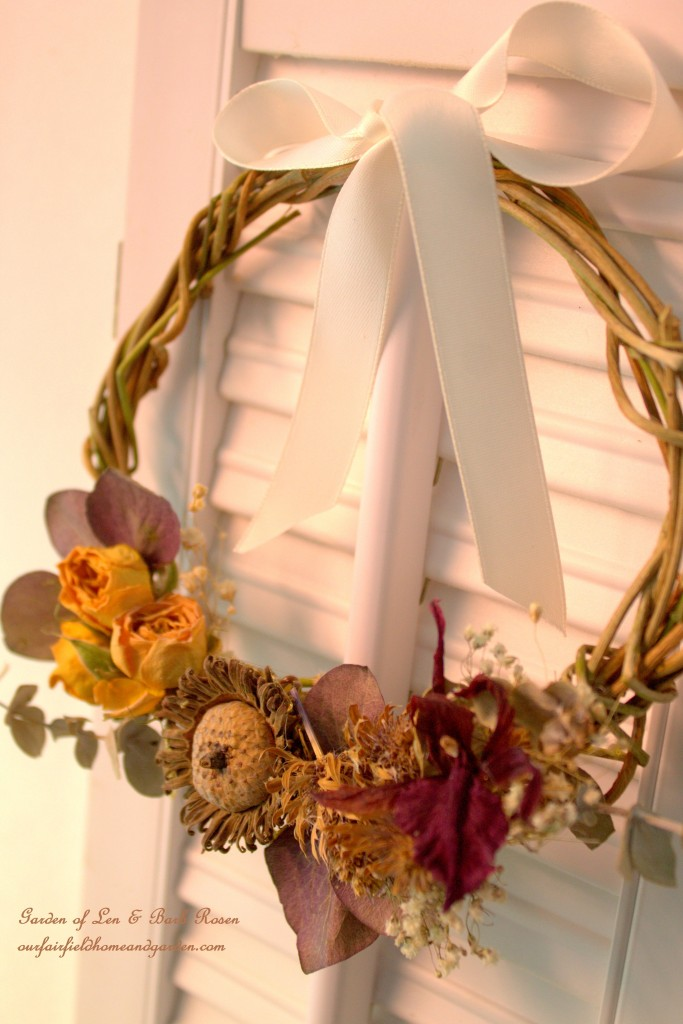 Natural Wreath with dried eucalyptus leaves, acorns, baby's breath, miniature roses and orchid flower     https://ourfairfieldhomeandgarden.com/diy-spring-wreaths/