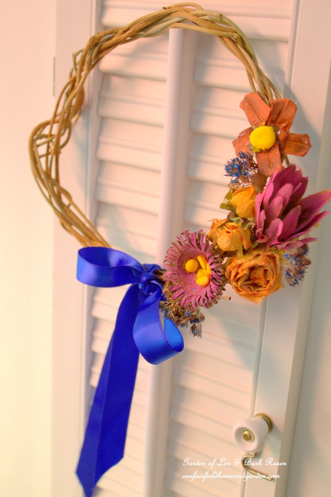 Natural materials wreath enhanced with watercolors. https://ourfairfieldhomeandgarden.com/diy-spring-wreaths/