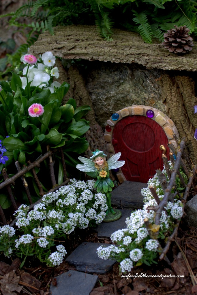 Fiona Fairy by her floral home https://ourfairfieldhomeandgarden.com/the-enchanted-guardians-come-to-my-garden/