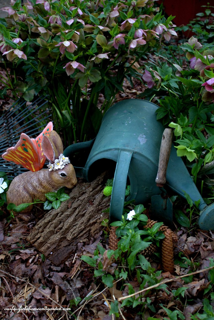 Queen Alice by her watering can warren. https://ourfairfieldhomeandgarden.com/the-enchanted-guardians-come-to-my-garden/