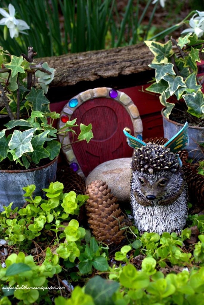 Spike the magical hedgehog outside his home.http://ourfairfieldhomeandgarden.com/the-enchanted-guardians-come-to-my-garden/