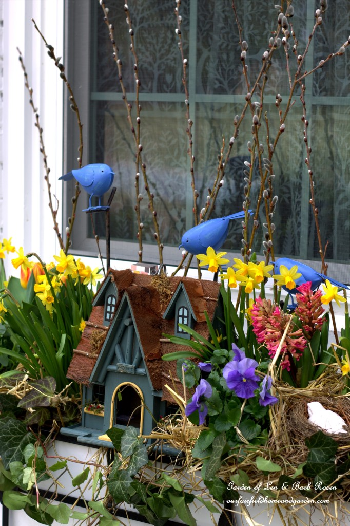 Birdhouse Themed Spring Windowbox https://ourfairfieldhomeandgarden.com/spring-fling-our-fairfield-home-and-gardens-windowboxes/