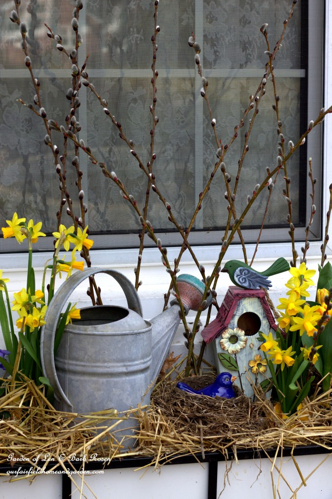 Watering Can and Birdhouse Windowbox http://ourfairfieldhomeandgarden.com/spring-fling-our-fairfield-home-and-gardens-windowboxes/