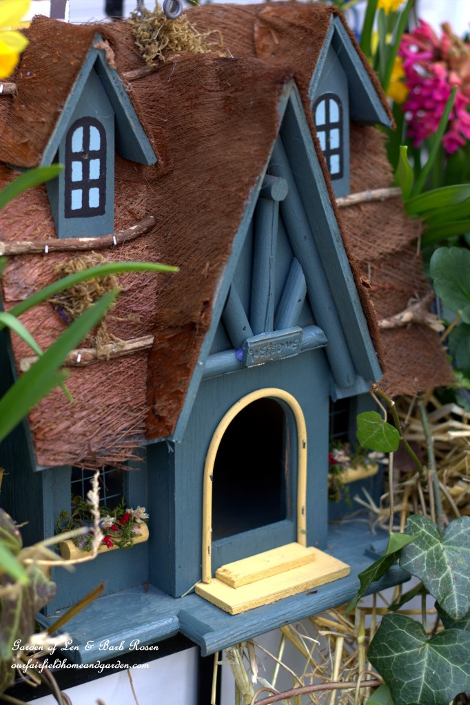 Blue Birdhouse in a spring windowbox. https://ourfairfieldhomeandgarden.com/spring-fling-our-fairfield-home-and-gardens-windowboxes/