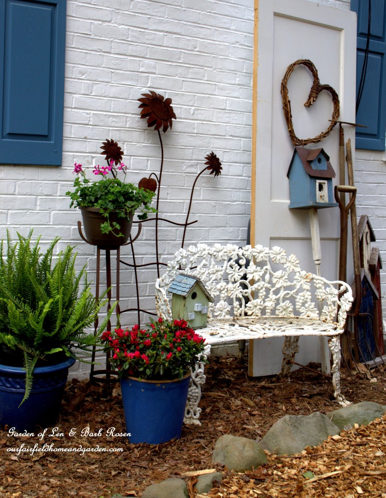 When you can't plant, make a vignette! http://ourfairfieldhomeandgarden.com/curb-appeal-hiding-an-eyesore-in-the-garden/