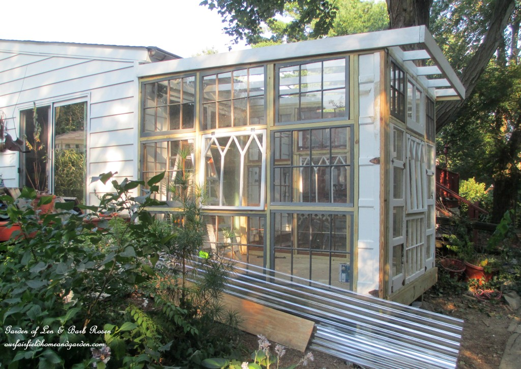 Building a repurposed windows greenhouse our fairfield for Garden glass house designs