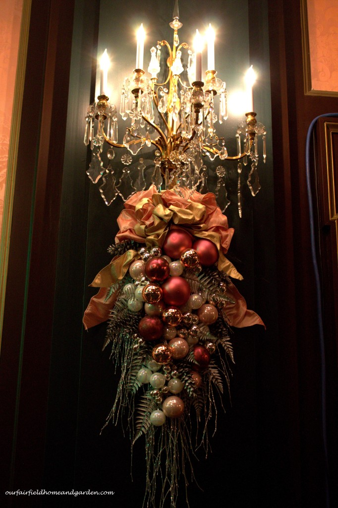 Holiday Sconces http://ourfairfieldhomeandgarden.com/a-longwood-christmas-evening-stroll/