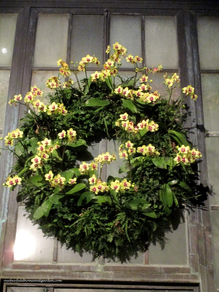 Orchid Wreath https://ourfairfieldhomeandgarden.com/a-longwood-christmas-evening-stroll/