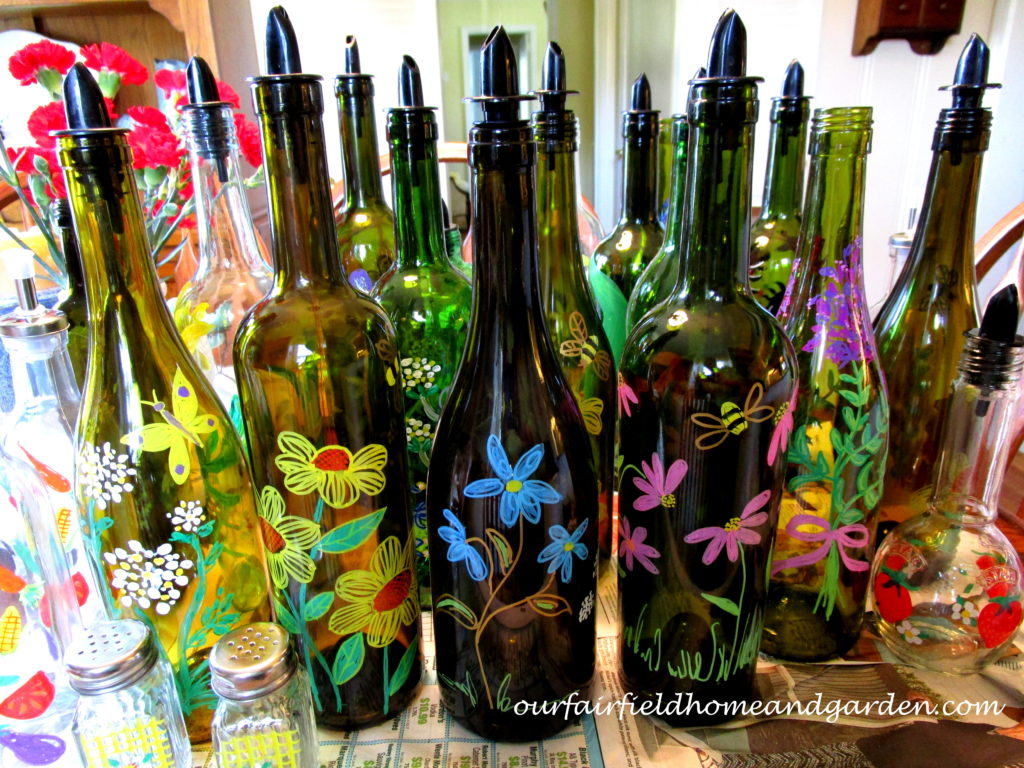 Painted Bottles https://ourfairfieldhomeandgarden.com/repurposing-handy-household-bottles-for-kitchen-and-laundry-use/