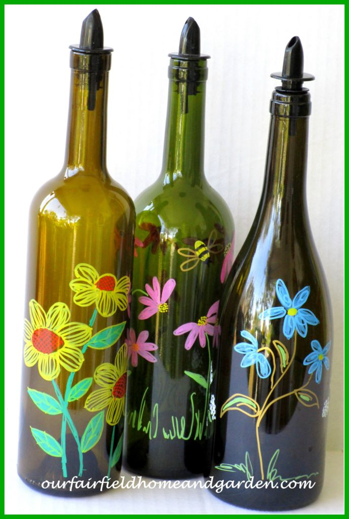 Painted Bottles http://ourfairfieldhomeandgarden.com/repurposing-handy-household-bottles-for-kitchen-and-laundry-use/
