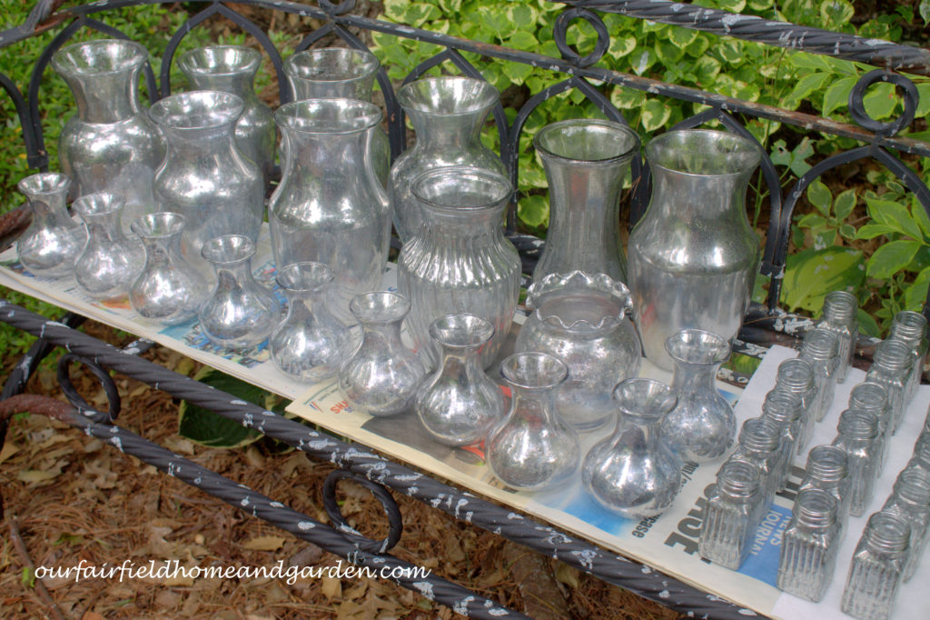 Finished DIY Faux Mercury Glass Vases https://ourfairfieldhomeandgarden.com/glam-up-your-wedding-glassware-wedding-flowers-for-less/
