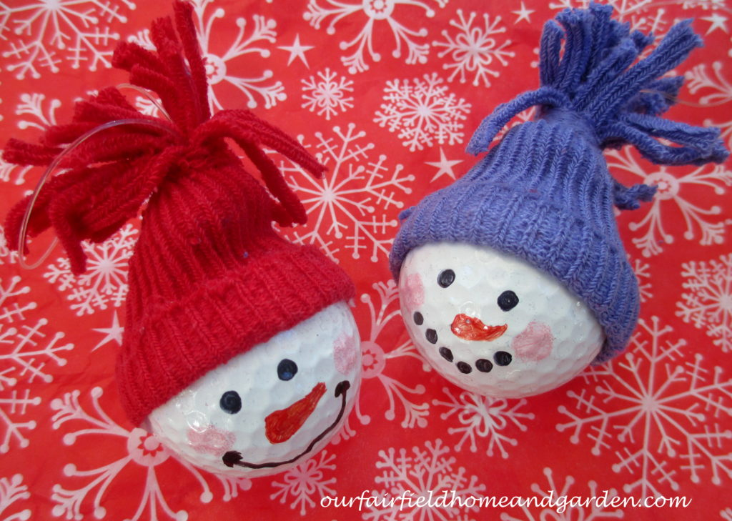 Snowman Ornaments ~ from golf balls! https://ourfairfieldhomeandgarden.com/snowman-ornaments-from-golfballs/
