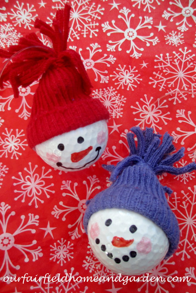 Snowman Ornaments ~ a quick and easy craft the whole family will enjoy! https://ourfairfieldhomeandgarden.com/snowman-ornaments-from-golfballs/