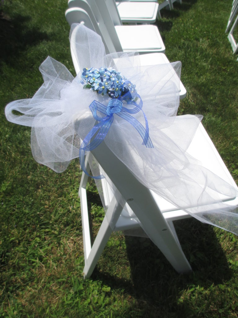 Wedding Chair Decorations http://ourfairfieldhomeandgarden.com/loving-touches-create-an-elegant-wedding-for-less/