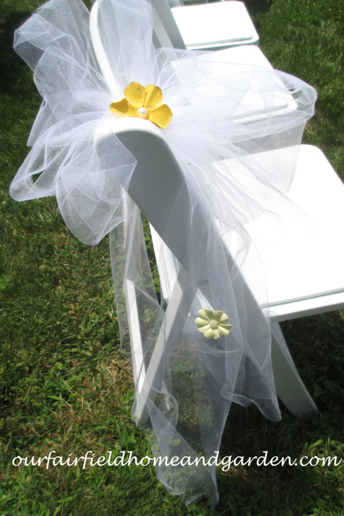 Wedding Seat Decorations http://ourfairfieldhomeandgarden.com/loving-touches-create-an-elegant-wedding-for-less/