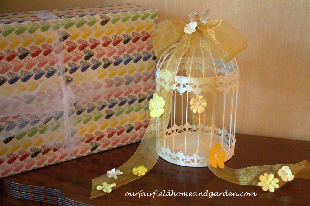 Decorated Birdcage Card Holder https://ourfairfieldhomeandgarden.com/loving-touches-create-an-elegant-wedding-for-less/