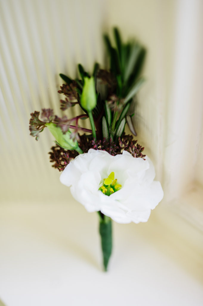 Boutonnieres http://ourfairfieldhomeandgarden.com/loving-touches-create-an-elegant-wedding-for-less/