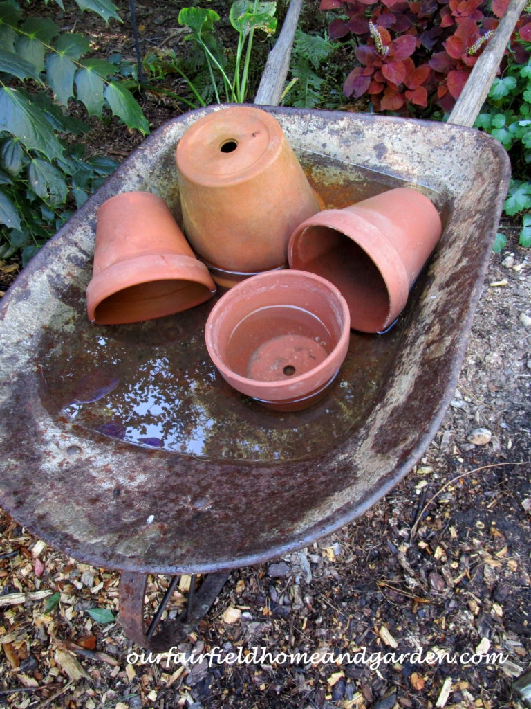 Wheelbarrow Water Feature http://ourfairfieldhomeandgarden.com/wheelbarrow-water-feature/