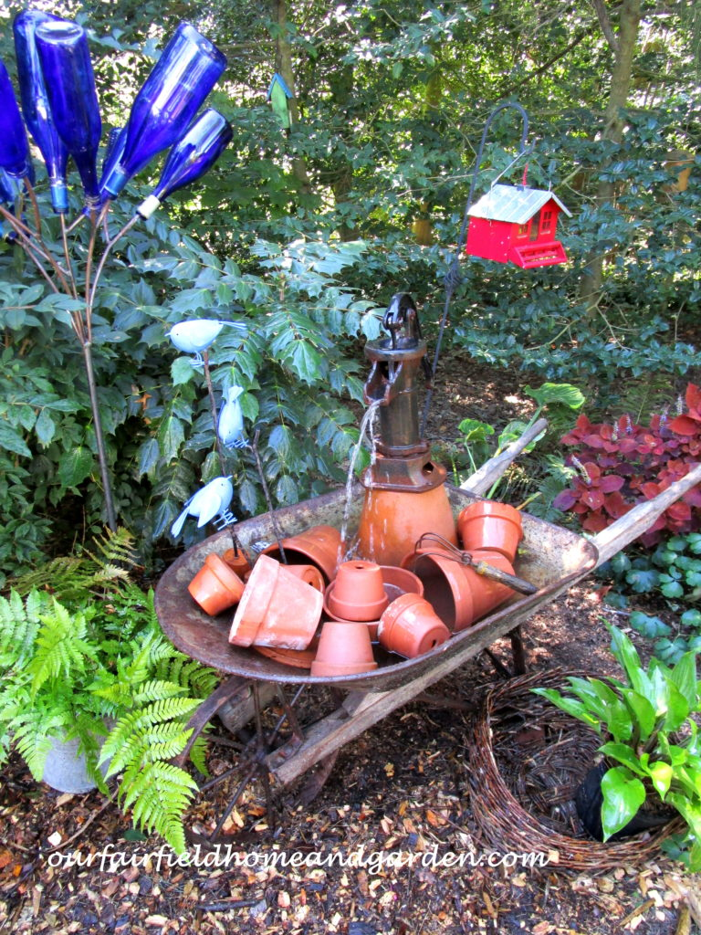 Wheelbarrow Water Feature https://ourfairfieldhomeandgarden.com/wheelbarrow-water-feature/