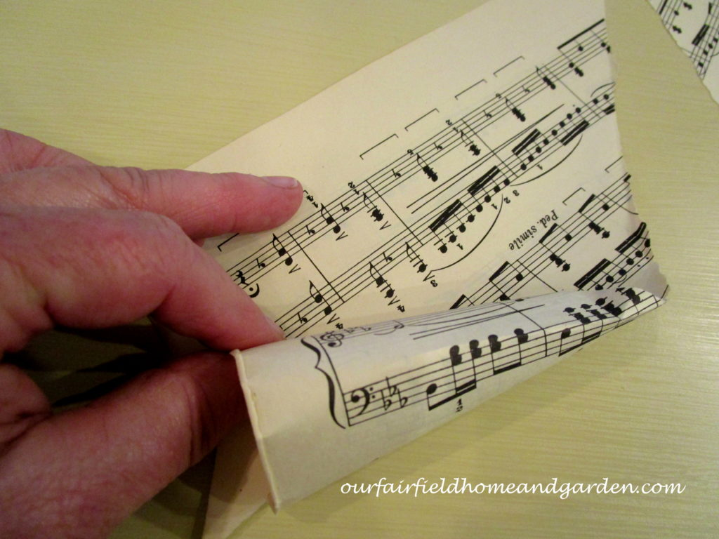 Music Sheet Christmas Tree https://ourfairfieldhomeandgarden.com/diy-make-music-sheet-christmas-trees/